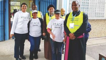 Peace monitors with Thabo Makgoba (on right), the Anglican archbishop of Cape Town. Photos courtesy of the authors.